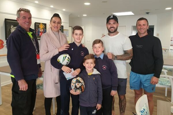 St Andrews Catholic Primary School Malabar - students with Souths football player Adam Reynolds