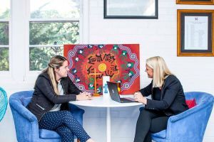 St Andrews Catholic Primary School Malabar - staff talking to each other with laptop