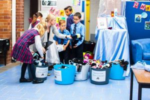 St Andrews Catholic Primary School Malabar - students sorting items into containers