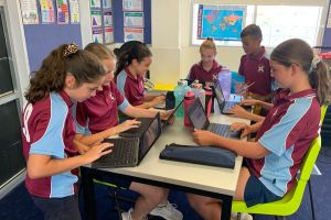 St Andrews Catholic Primary School Malabar - students doing school work in their laptops