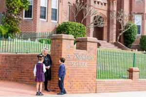 St Andrews Catholic Primary School Malabar - Principal talking to students in front of school gate